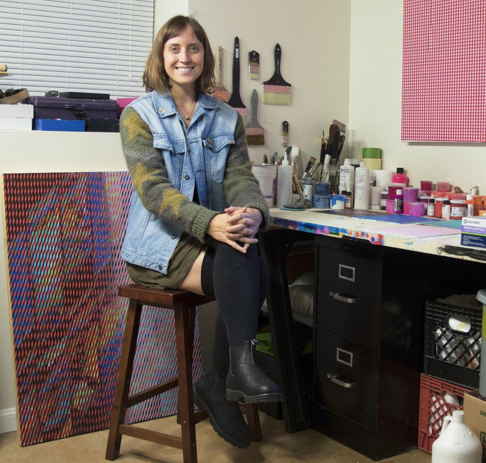 Rebecca Kaufman  posing in her studio
