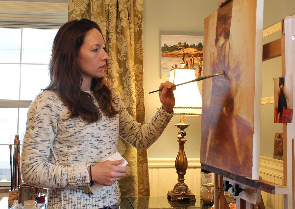 Artist Jonelle Summerfield working in her studio.