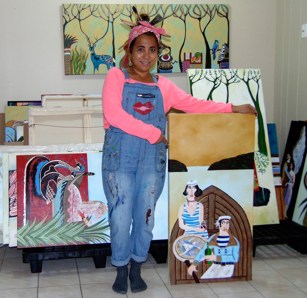 Diana Rosa standing amid her artwork.