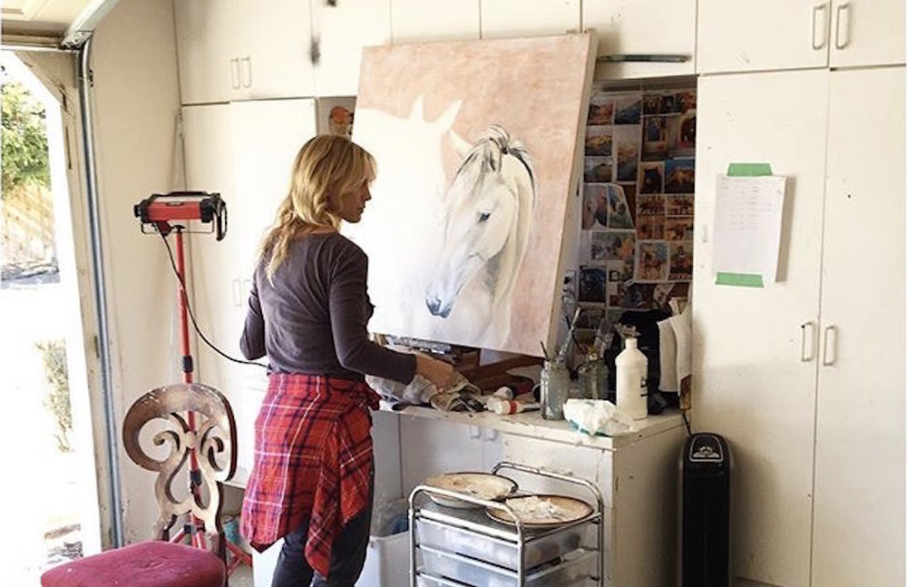 New artist Alana Clumeck working in her studio.