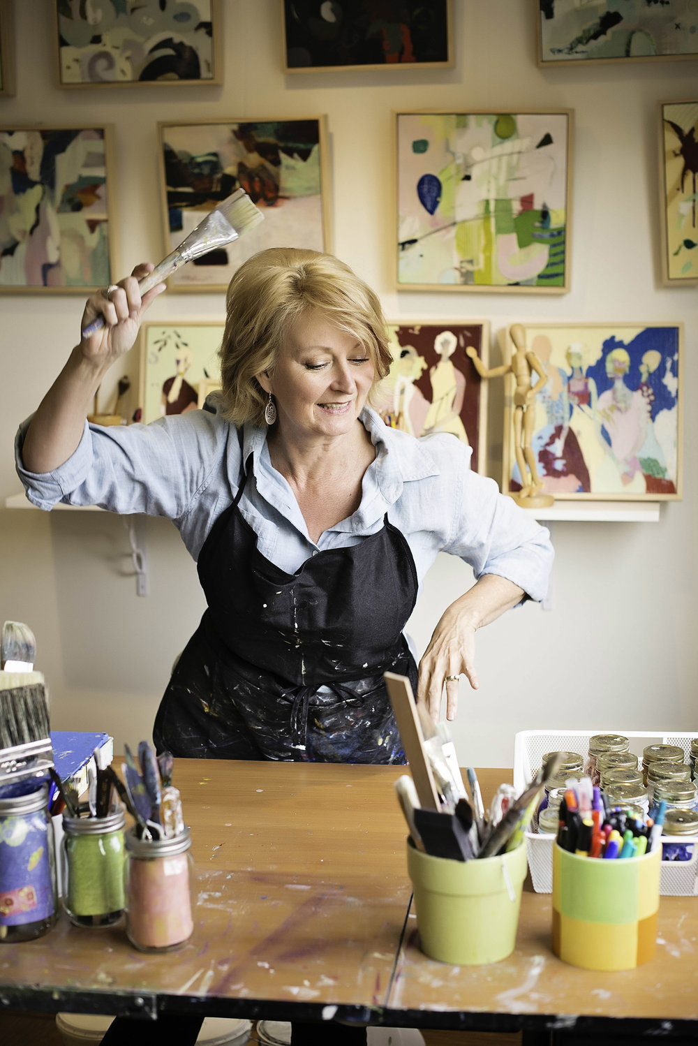 Pamela Beer  enjoying the artistic process in her studio.