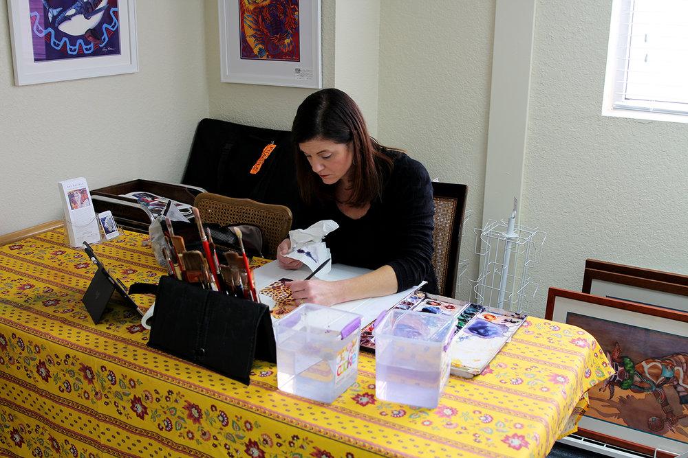 New UGallery artist Amy Rattner working with watercolors in her studio.