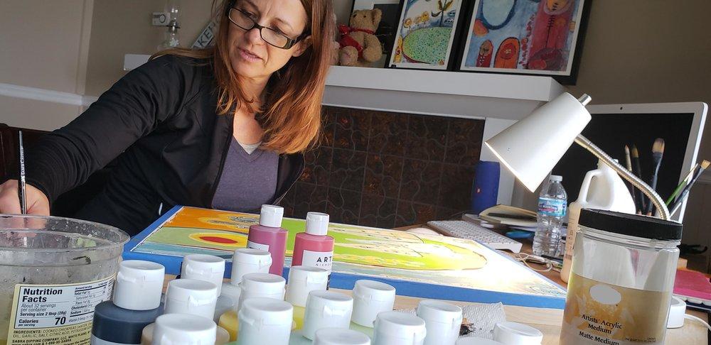 New UGallery artist  Pamela Roberson  painting in her studio.