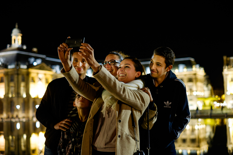 Family photo at Place de la Bourse