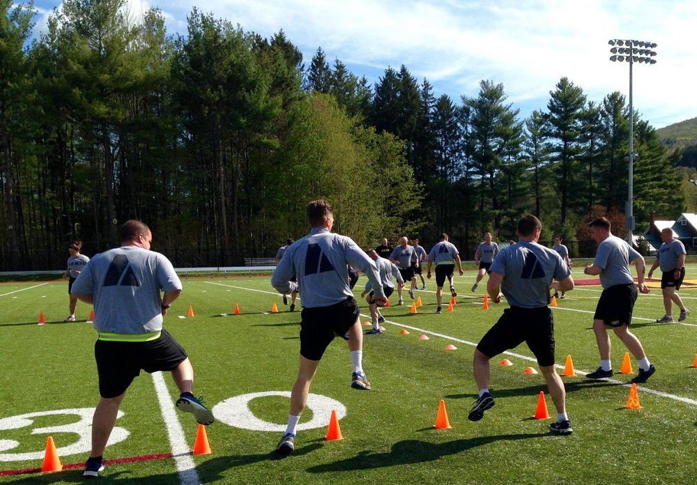 National Guard running over cones during OnTrack fitness training session