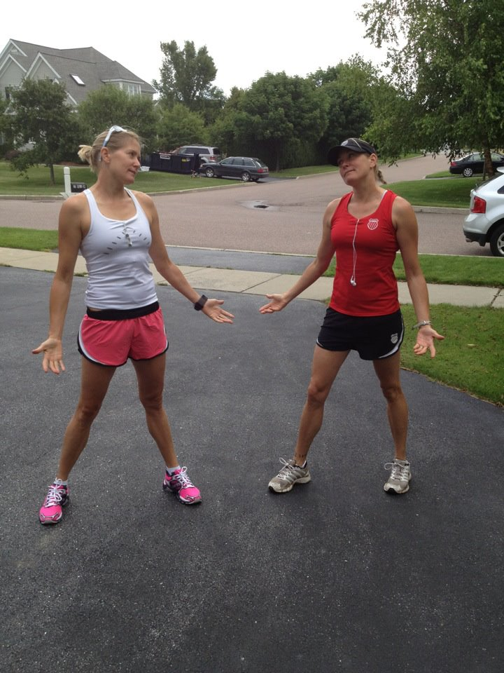 Kim and Kelly facing one another in running gear