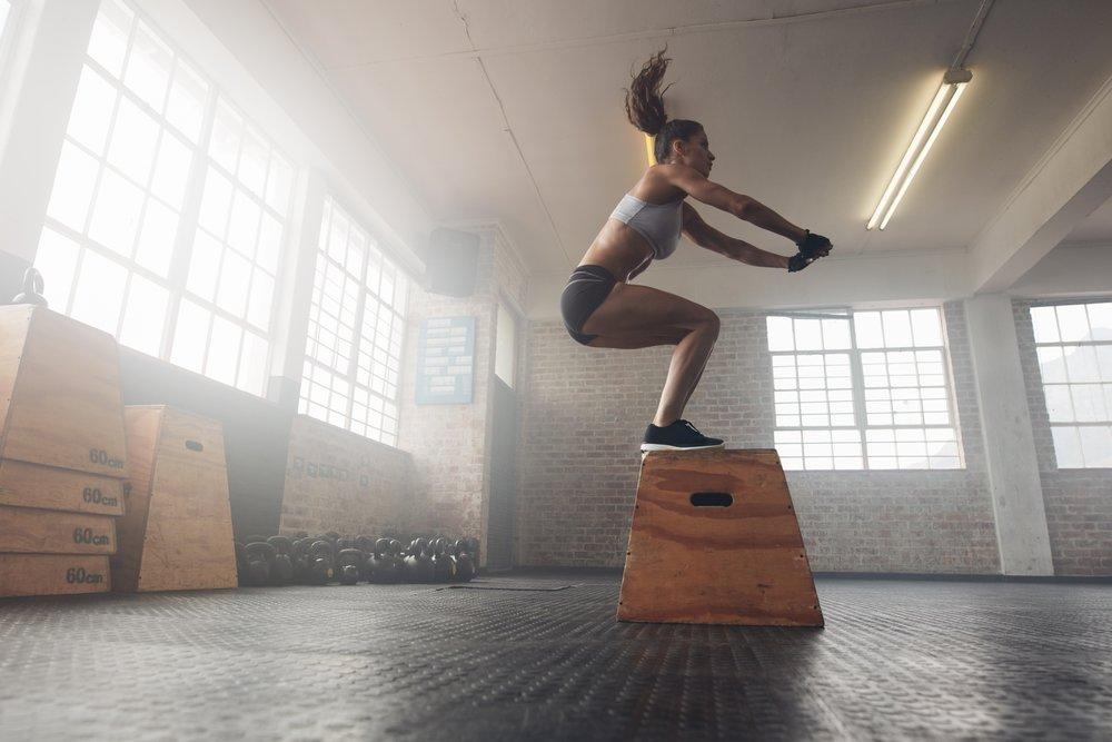 bigstock-Woman-Doing-A-Box-Squat-At-The-131406365.jpg