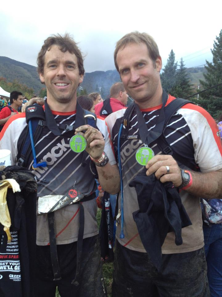 Michael Dabbs (left) with Brian Loeffler, OnTrack physical therapist, after completing a Spartan Beast