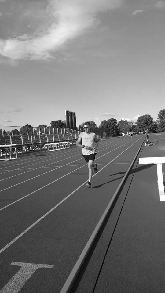 Man-running-on-track