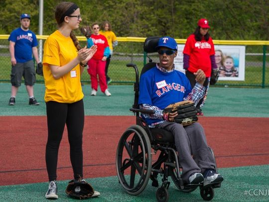 22-year-old Mark Black, Blackwood (right) with his buddy Zoe Culver, a freshman at Cherry Hill East. (Photo: Joseph Nasto/Camden County NJ Miracle League)