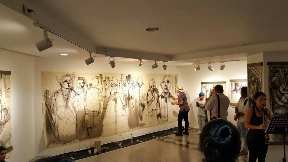 Mural sized canvas being painted in live in Sala Carlos Drew Castro in Instituto de Cultura y Fomento al Turismo in Colombia