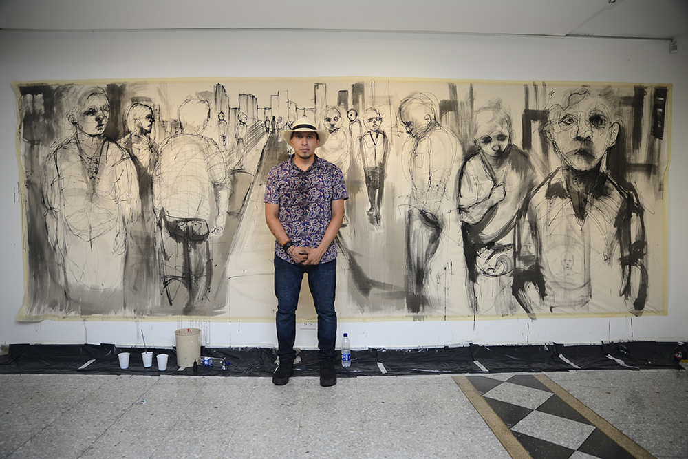 Toronto based, Colombian born visual artist Carlos Delgado in front of his live painted piece for his solo gallery art show in Colombia.