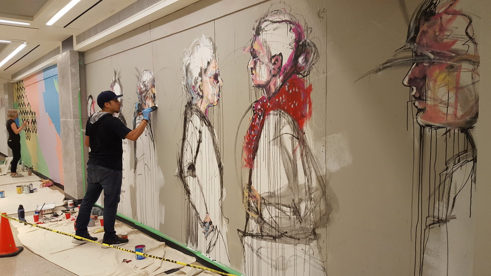 Culture Days live mural painting at Union Station, Toronto, adding colour to the moving people.