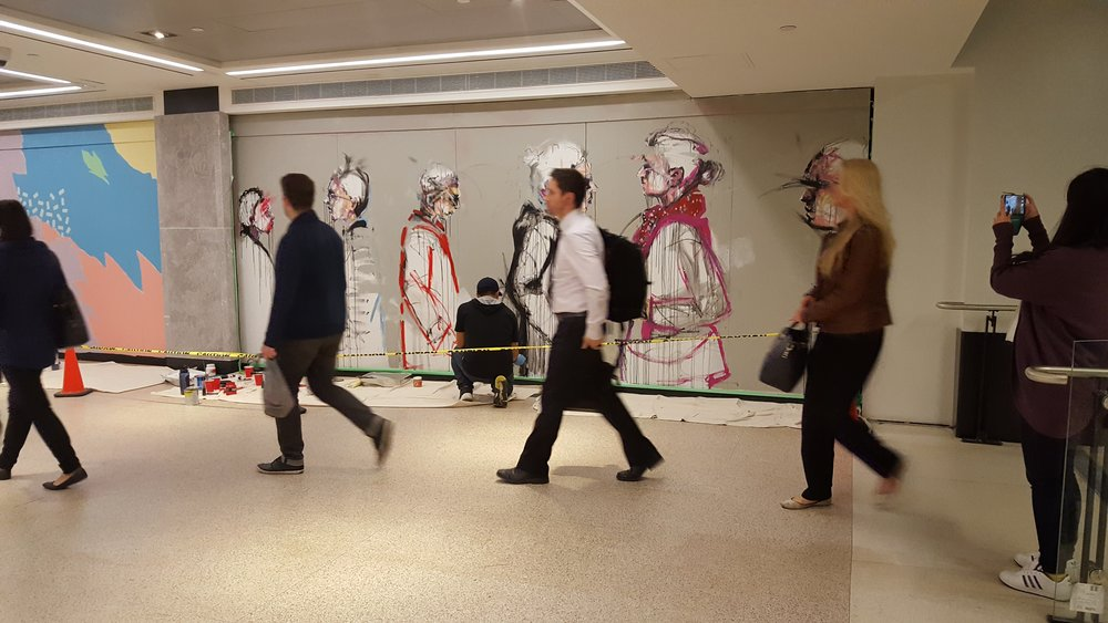 Morning commuter rush by live mural paintings in Union Station Toronto