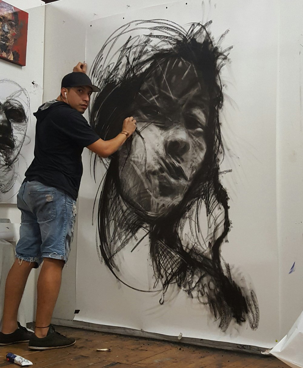 Large scale charcoal drawing in process at Carlos Delgado's art studio in Toronto