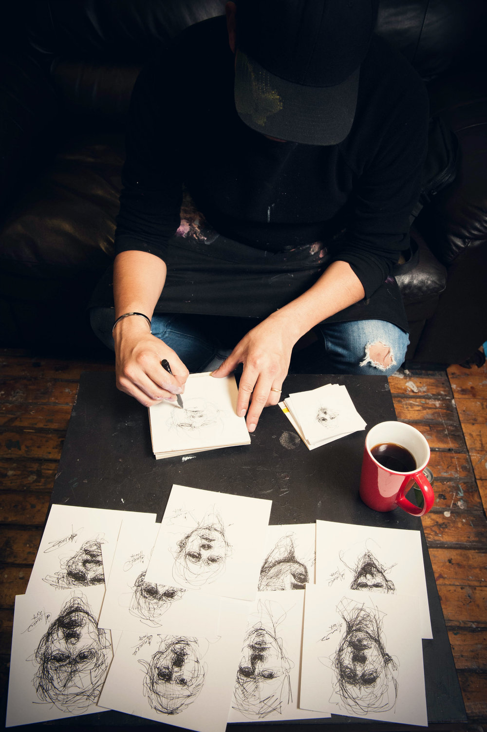 Drawing small scale sketches. Carlos Delgado in his studio in Toronto. Photo by Alex Usquiano.