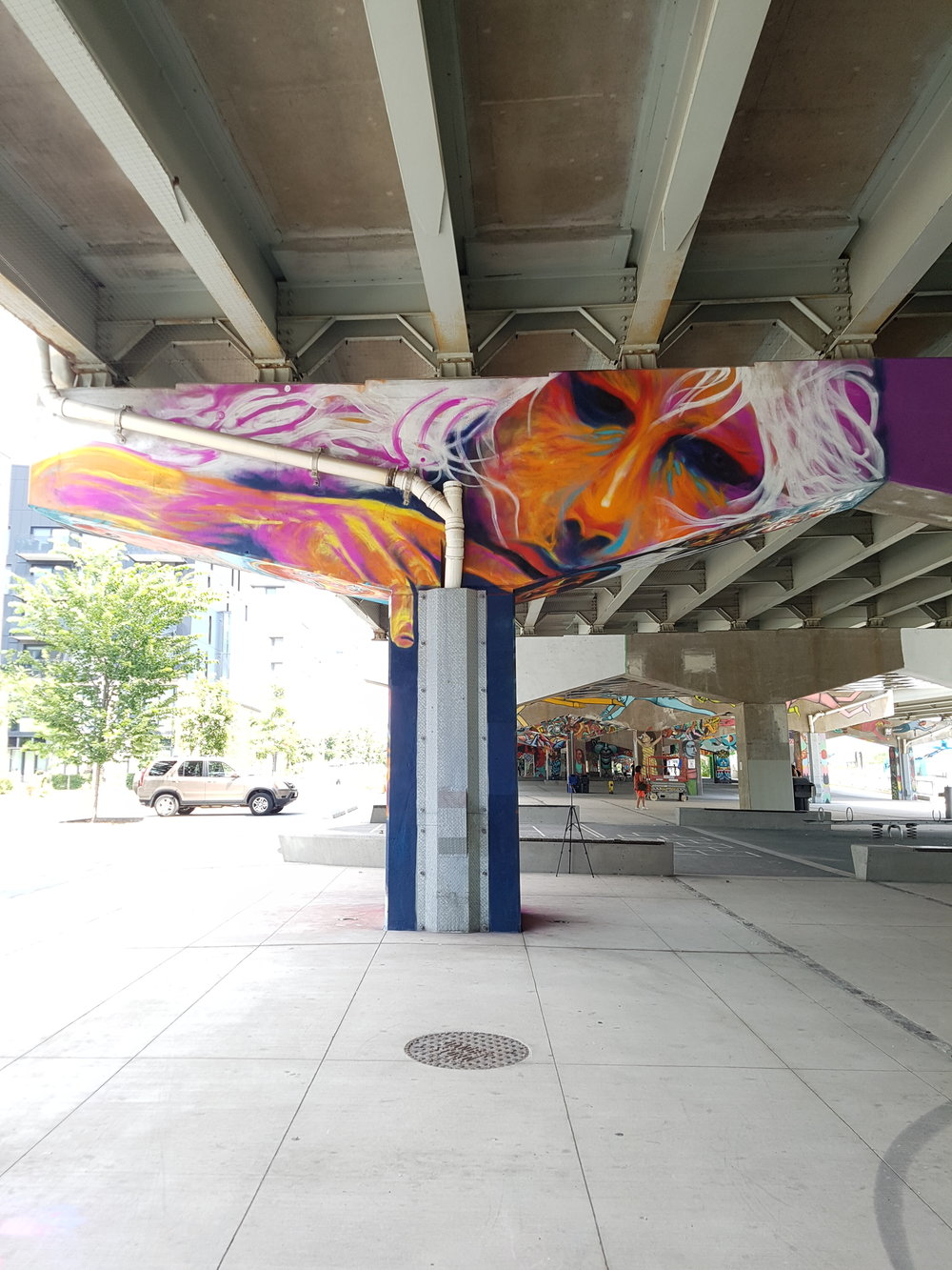 Wide photo of street art in Toronto.