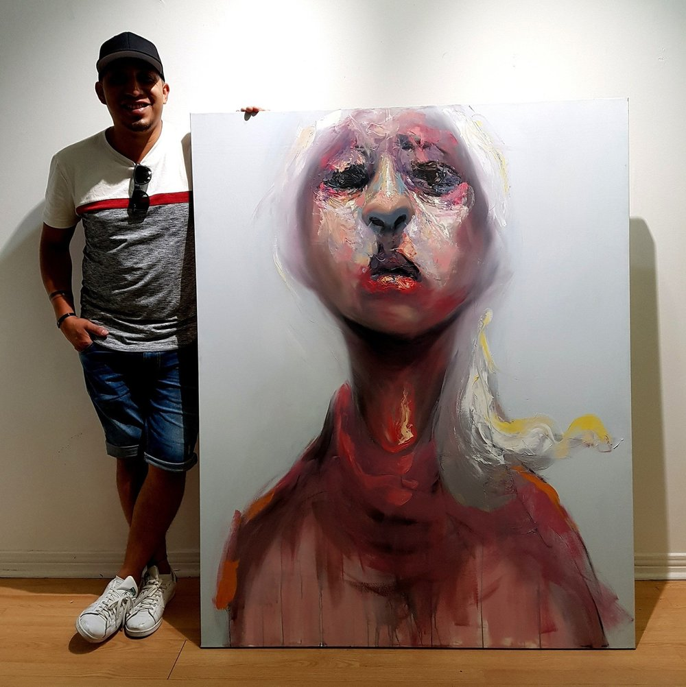 Artist Carlos Delgado with the piece before sending it off to a collector in Shanghai. Art travels around the world.