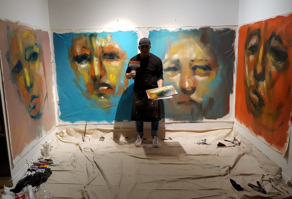 Carlos Delgado, visual artist painting large scale abstract portraits downtown Toronto