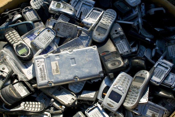 Old cell phones can leak all kinds of hazardous elements into soils around landfills and potentially contaminate nearby groundwater supplies. Credit: SteveStLouis, FlickrCC.