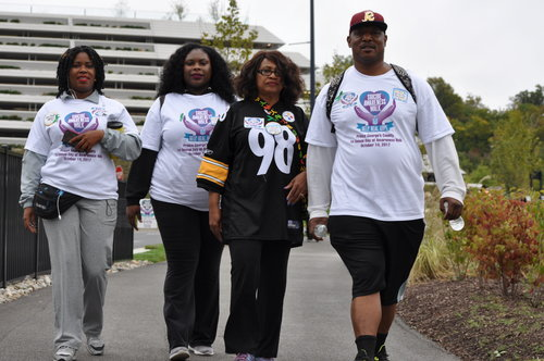 For Markeith: (r-l) Cortez Avery, Alice Holt (wearing her son Markeith's Steelers' jersey), Naisha Holt and a friend join the walk Oct 14 to aid suicide awareness and prevention.