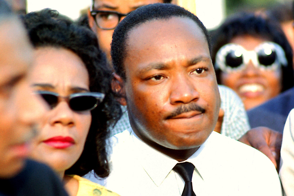 Martin Luther King, Jr. appears in Grant Park in Chicago in 1966. His wife Coretta Scott King is at left. / Photo Credit: Bernard Kleina