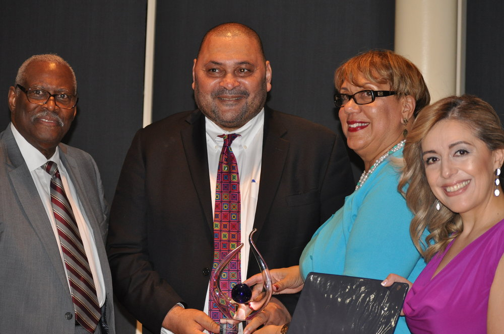 """Love is the mission: (l-r) MOLC Founder Doug Edwards, Arthur J. Horne, winner of the Bucky Trotter Award, M-NCPPC Chair Elizabeth """"Betty"""" Hewlett and MOLC CEO Ana Paola Bueno. PHOTO: PRINCE GEORGE'S SUITE MAGAZINE & MEDIA"""