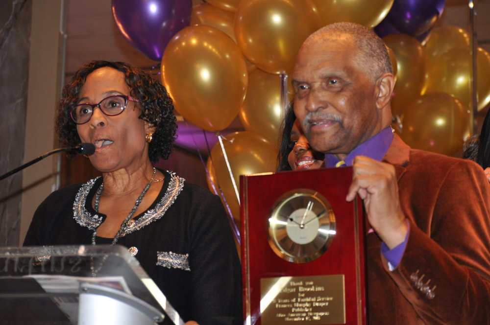 Dr. Frances Draper, CEO and publisher of the Afro American newspapers (left) presents Edgar Brookins with an award that epitomizes Brookins' long hours and work ethic. PHOTO: RAOUL DENNIS // PRINCE GEORGE'S SUITE MAGAZINE & MEDIA