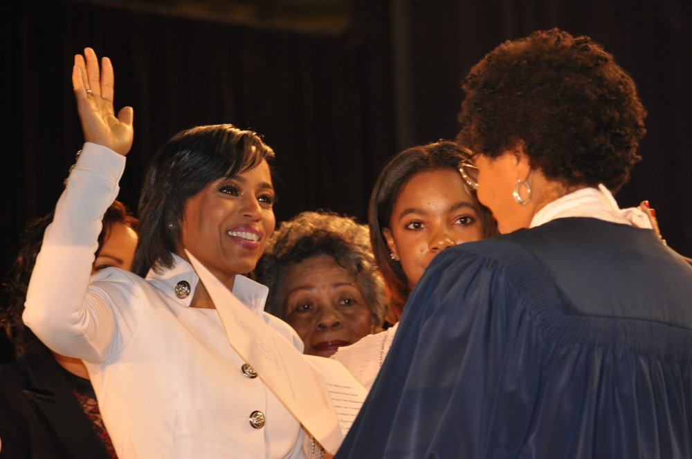 Alsobrooks being sworn in with her mother, Patricia, at center and daughter, Alexandra, at right. PHOTO: AMIR STOUDAMIRE