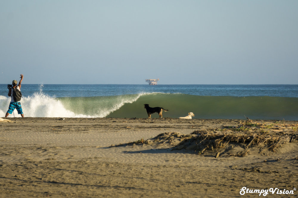 Local surfer and photographer Darwin Atalaya Obando salutes.