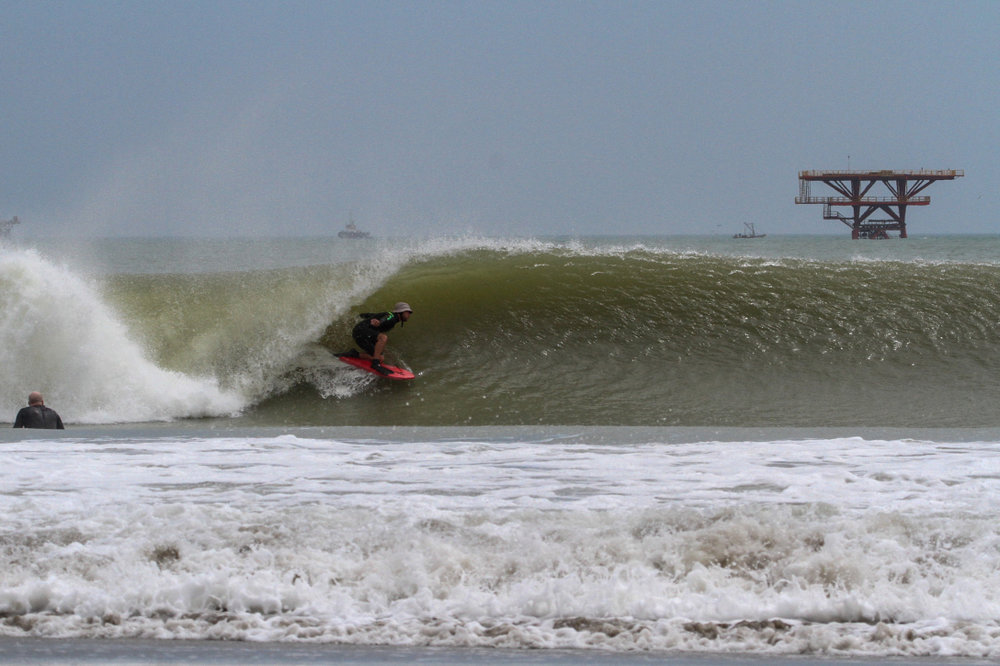 Short bladed fins are my fin of choice to help lock into waves like this in Peru.