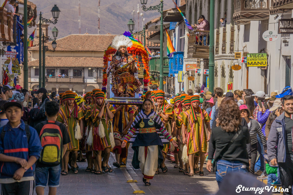 The precoccession through the streets of Cusco.