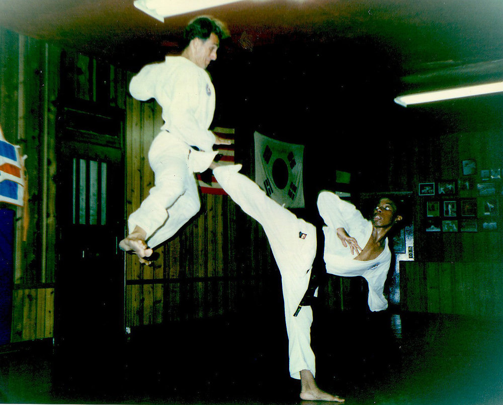 (Master) A. Ross executing a jumping punch/block side kick at Bronx Tae Kwon Do institute in Parkchester, Bronx, circa 1990s.