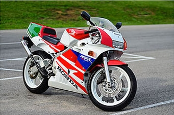 Honda NSR250R   Based on the most dominant Grand Prix bike of all-time, the legendary Honda NSR500, which captured 10 championships and over 100 wins in less than two decades. With its racing pedigree, v-twin engine, and Honda stamp of quality, this is the GP replica to own. Our hands down favorite bike.