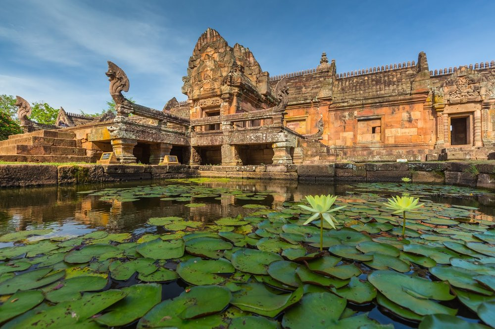 ancient Khmer temple in Buriram, Thailand surrounded by a lotus pond