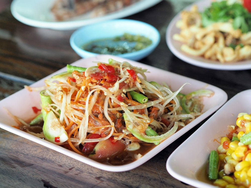 Thai spicy shredded papaya salad som tam