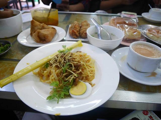 burmese noodles and milk tea at a tea house in Yangon