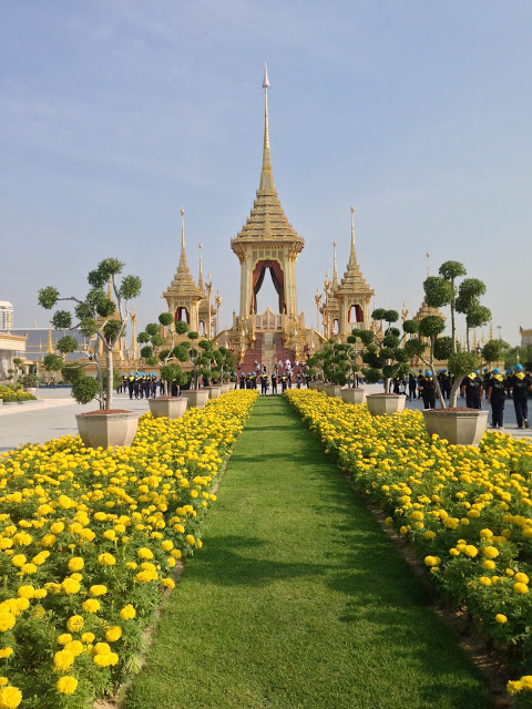the royal crematorium pavilion of HM King Rama IX of Thailand and field of yellow marigolds