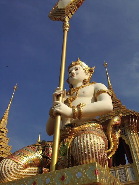 golden statues from Thai cosmology at royal crematorium