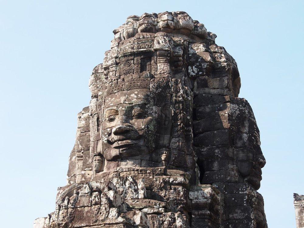 carved stone heads bayon at angkor  thom cambodia