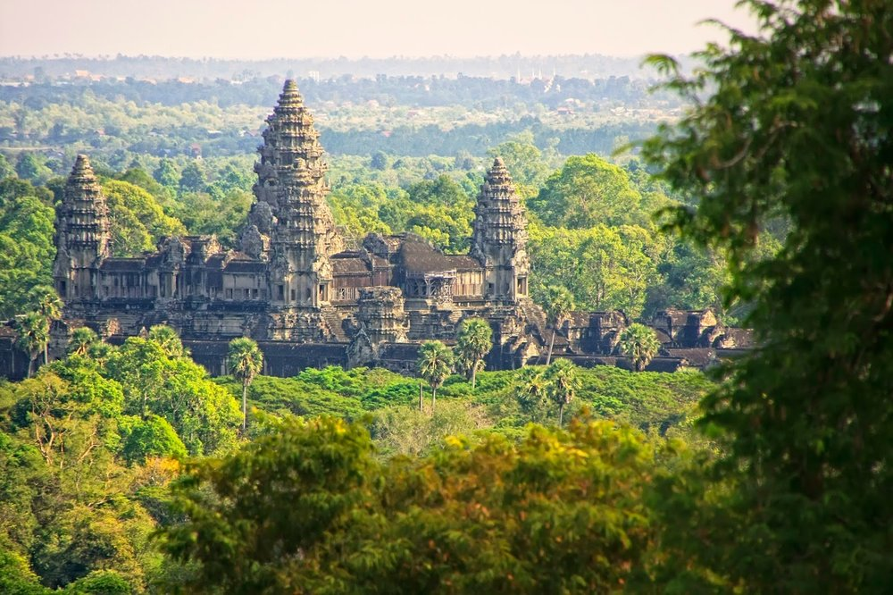 stone temple angkor wat surrounded by jungle siem reap cambodia