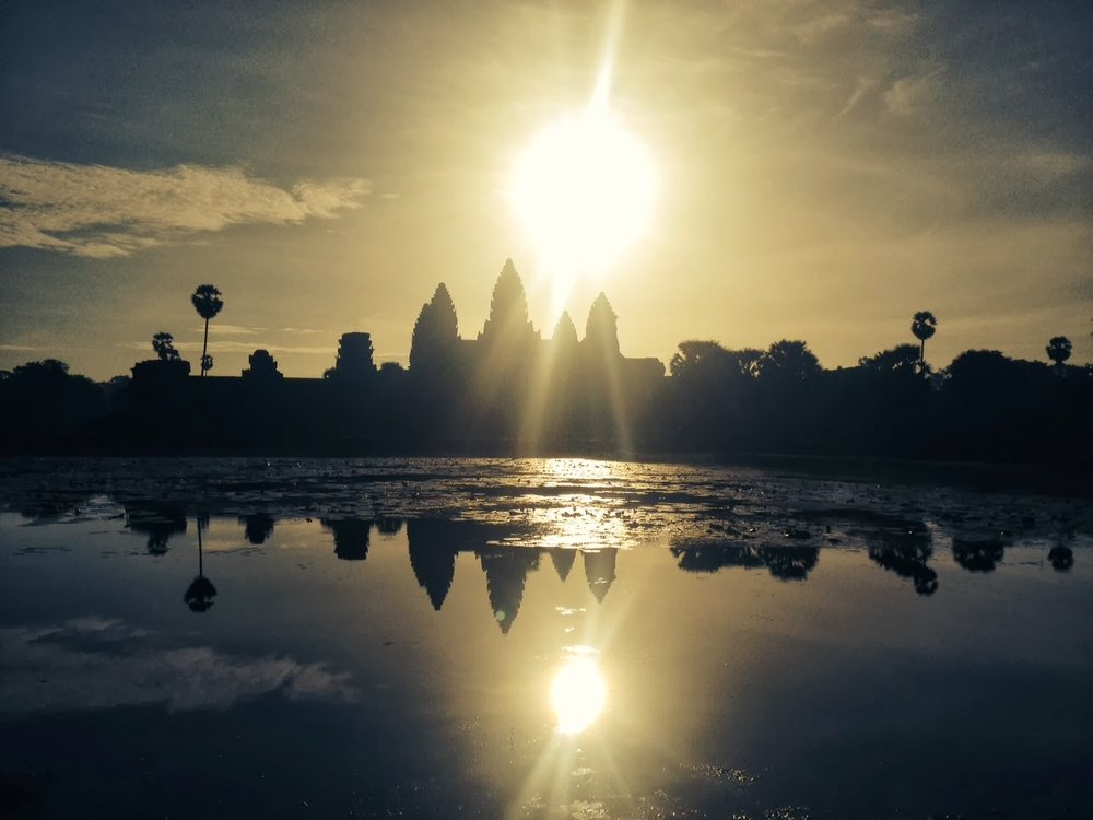 golden sunrise and reflection in water of Angkor Wat, cambodia