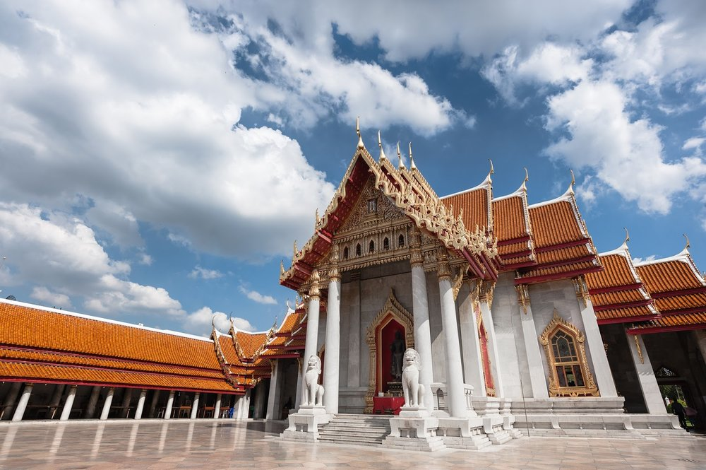 red, white, and gold Thai temple