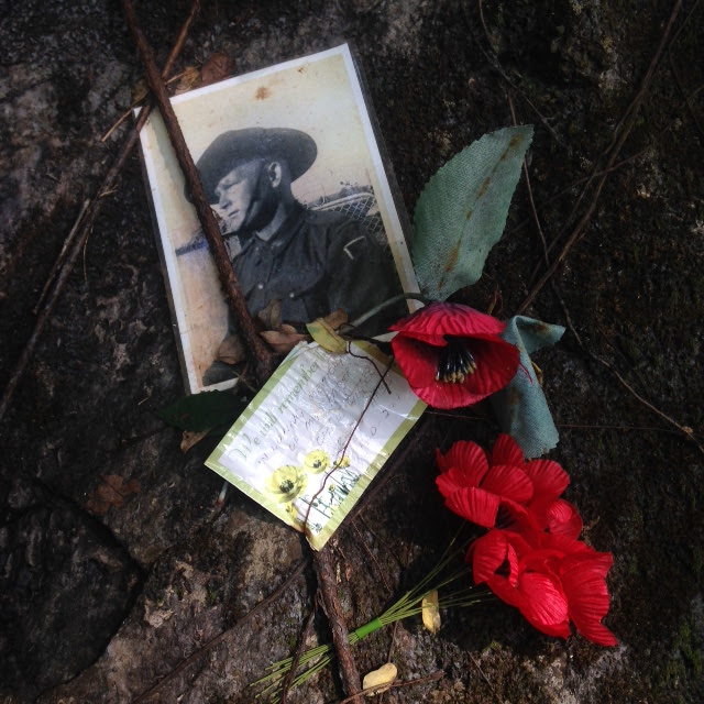 old photo of a WW2 soldier POW and red poppy flower at Hellfire Pass Memorial along the Thai-Burmese Death Railway in Kanchanaburi, Thailand