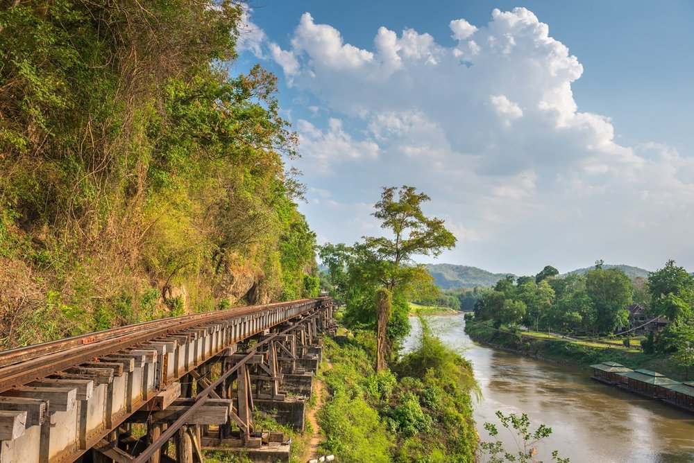 tracks along the trestle bridge in cliffside of death railway wangpo kanchanaburi Thailand