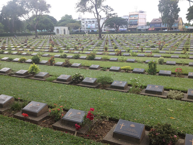 Allied War Cemetery with rows of tombstones in kanchanaburi thailand from the bridge on the river kwai