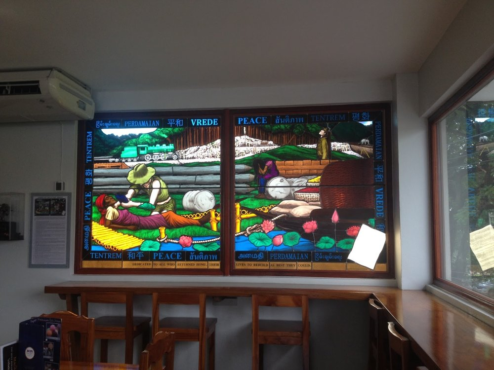 stained glass windows depicting construction of kanchanaburi death railway during second world war