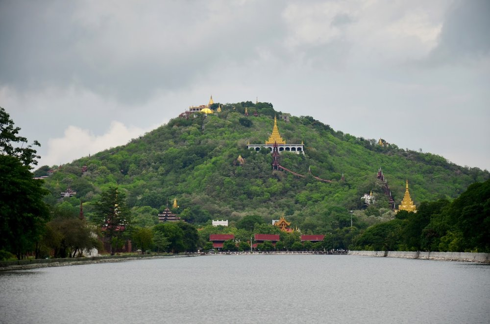 mandalay hill in myanmar with golden temples