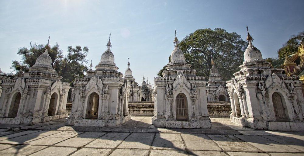 white stone stupas a mandalay kuthodow pagoda