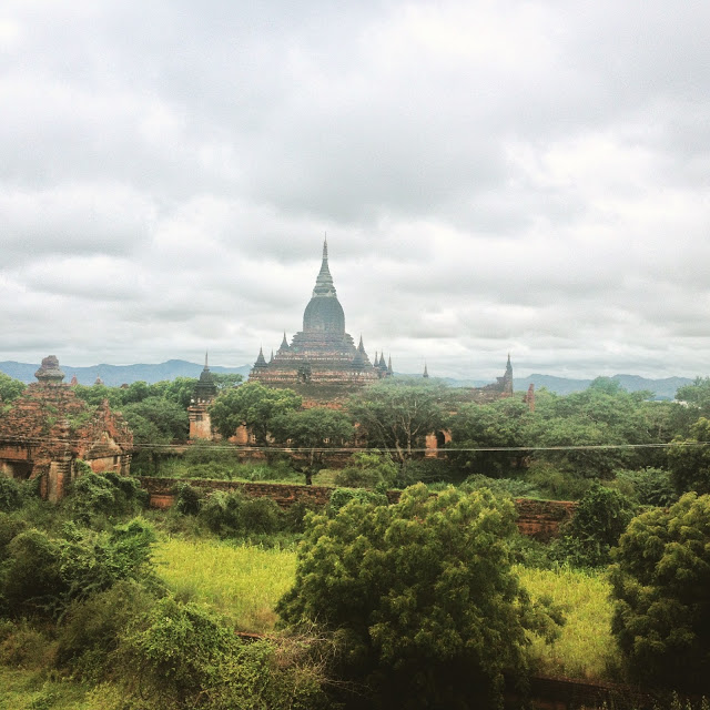 stone temples in green field bagan myanmar